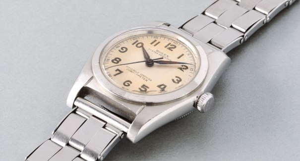 A fine and attractive stainless steel automatic wristwatch with luminous Arabic numerals and Gay Frères bracelet