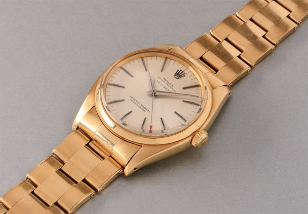 "A rare and attractive yellow gold wristwatch with ""dead-beat"" center seconds and bracelet"