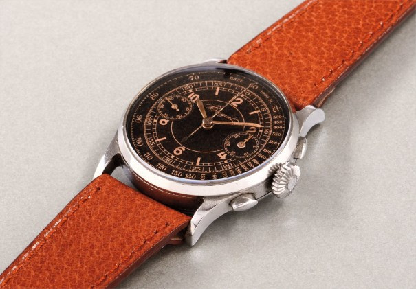 An extremely rare and elegant stainless steel chronograph wristwatch with 'tropical' black sector dial