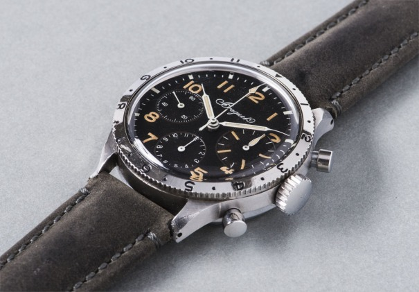 """A very attractive and extremely rare stainless steel chronograph wristwatch with black dial and rotating bezel, caseback engraved """"Esso J.B. Champion Du Monde 1959"""""""