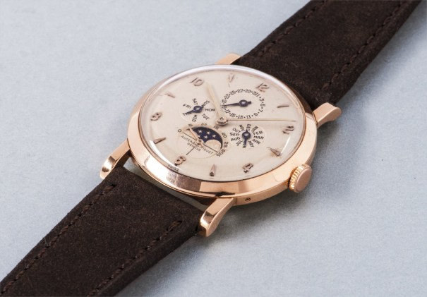 A fine and extremely rare pink gold triple calendar wristwatch with phases of the moon