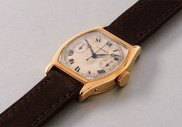 An attractive and extremely rare yellow gold single button chronograph wristwatch