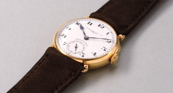 "A fine and attractive yellow gold ""Officier"" style wristwatch with white enamel dial, retailed by Eberhard-Milan"
