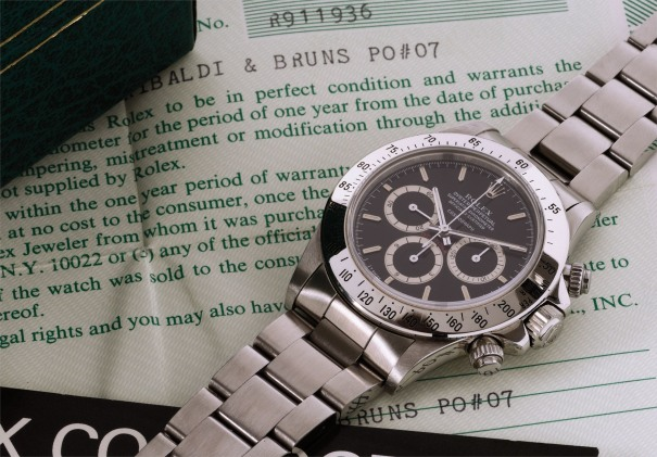 A rare and very attractive stainless steel chronograph wristwatch with black dial, bracelet and certificate