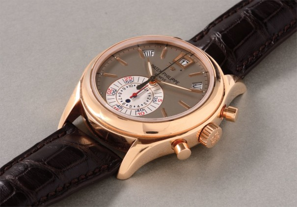 A rare and attractive pink gold chronograph wristwatch with annual calendar, power reserve indication, original certificate and box