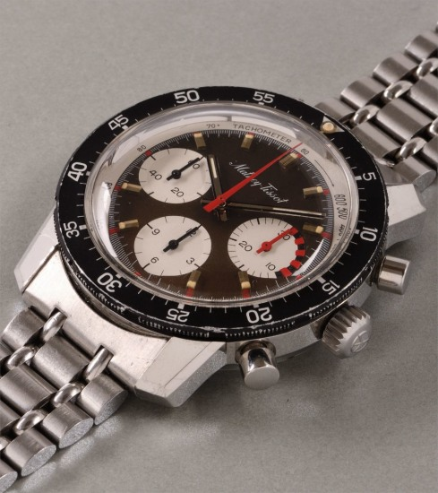 A rare and attractive stainless steel chronograph wristwatch with 'tropical' dial