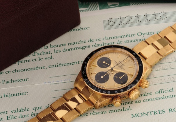 A very attractive and rare yellow gold chronograph wristwatch with guarantee, invoice and box