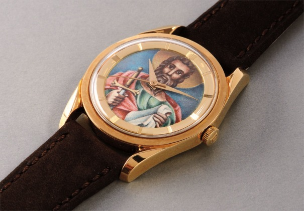 A fine and very rare yellow gold automatic wristwatch with polychrome enamel dial