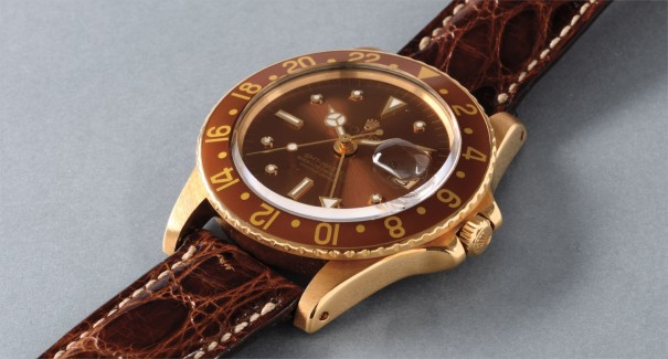 A very attractive yellow gold wristwatch with 24 hour hand, date, brown bezel and brown dial