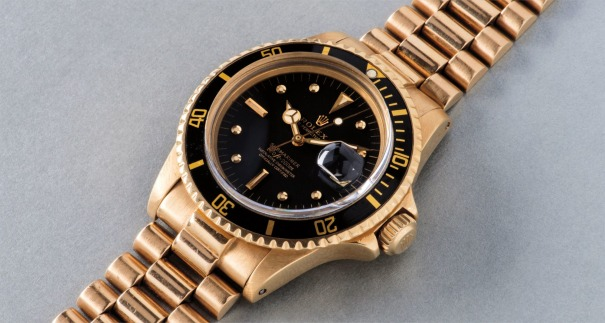 A fine and attractive yellow gold diving wristwatch with date, center seconds and bracelet