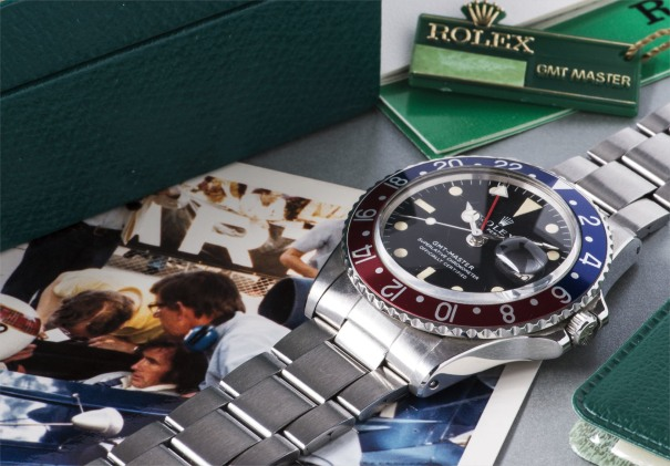 A historically interesting stainless steel wristwatch presented to motorsport designer and constructor Derek Gardner by race legend and Rolex ambassador Sir Jackie Stewart, with bracelet, dual-time zone, accompanied by presentation box, punched certificate, punched and stamped booklet, GMT Master pamphlet and period Grand Prix photographs