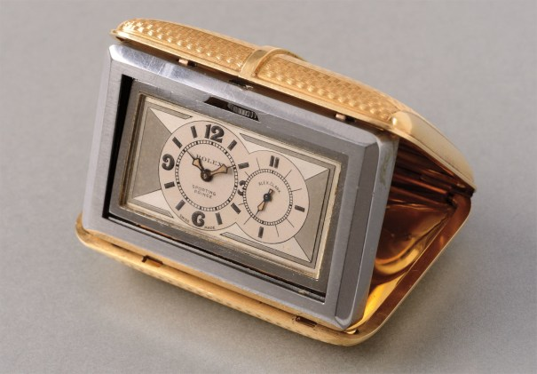 An extremely rare, attractive and unusual yellow gold travel timepiece