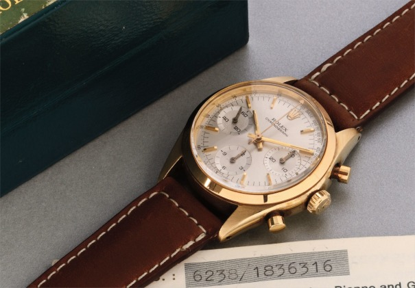 A fine and attractive yellow gold chronograph wristwatch with original guarantee