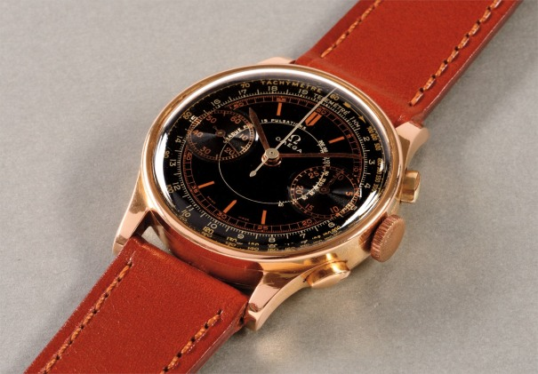 A highly attractive and rare pink gold chronograph wristwatch with black lacquer dial and triple scale