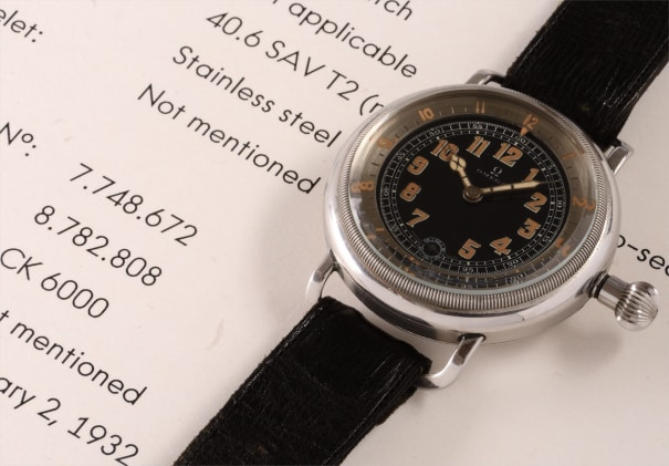 An extremely rare and important aviator's wristwatch with black dial and elapsed time indicator