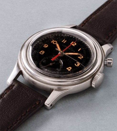 A very rare and unusual stainless steel single-button fly-back chronograph wristwatch with black glossy dial and red central elapsed minute counter