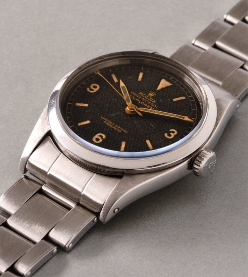An early and rare stainless steel wristwatch with black honeycomb dial, center seconds and bracelet