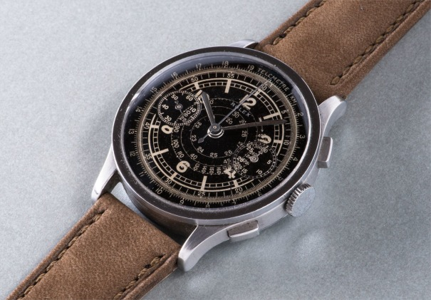 A rare and highly attractive stainless steel chronograph wristwatch with black dial, tachymeter and telemeter scales