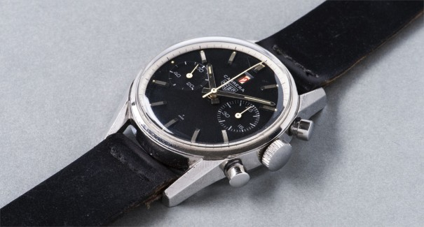 An attractive and rare stainless steel chronograph wristwatch with black dial and red date