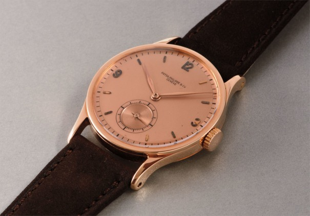 A very rare and large pink gold wristwatch with two-tone pink dial