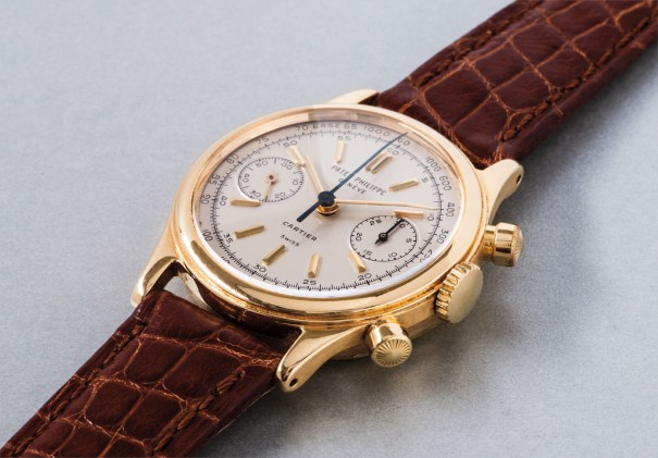 A very exclusive and highly attractive yellow gold chronograph wristwatch with silvered dial, gold hour markers and tachymeter scale, retailed by Cartier