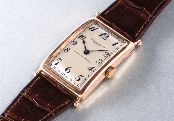 An extremely fine and possibly unique pink gold oversized rectangular hinged wristwatch with Breguet numerals, retailed by Gondolo & Labouriau