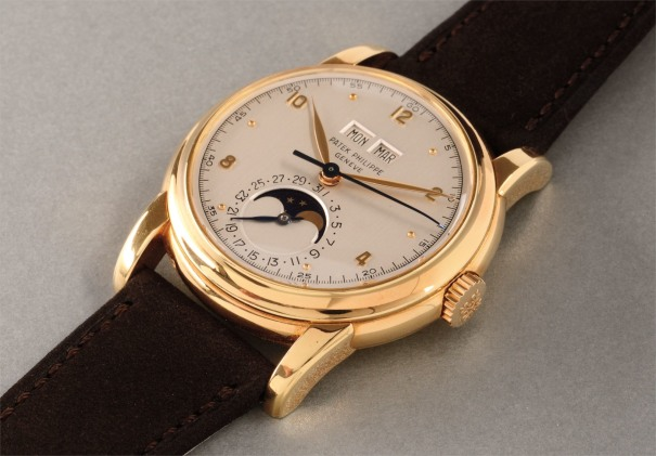 A very rare and highly attractive yellow gold perpetual calendar wristwatch with moonphases and sweep center seconds