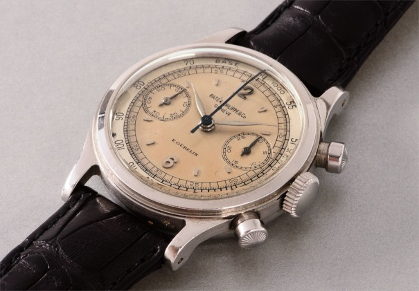 An extremely rare and highly attractive stainless steel chronograph wristwatch with two tone silvered dial with tachymeter scale, retailed by E. Gübelin