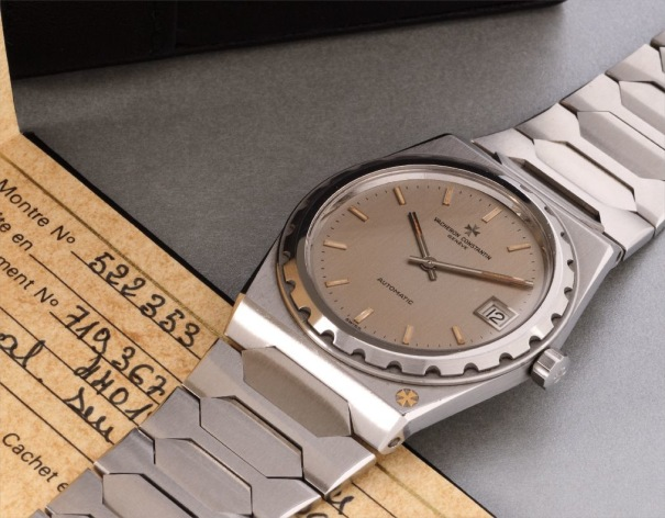 A rare and attractive stainless steel wristwatch with date, bracelet, original box and certificate