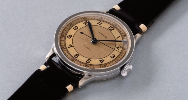 A very rare, oversized and  attractive stainless steel wristwatch with three tone dial and center seconds
