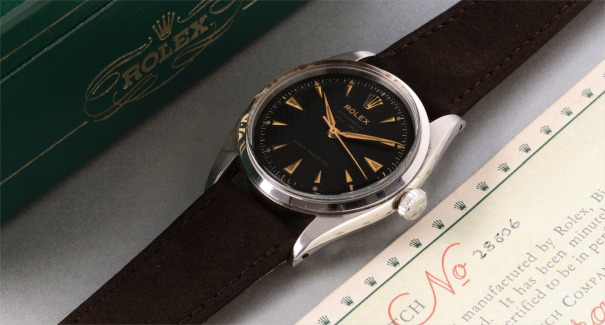 "A very attractive stainless steel wristwatch with black ""depth rated"" honeycomb dial, guarantee and box"