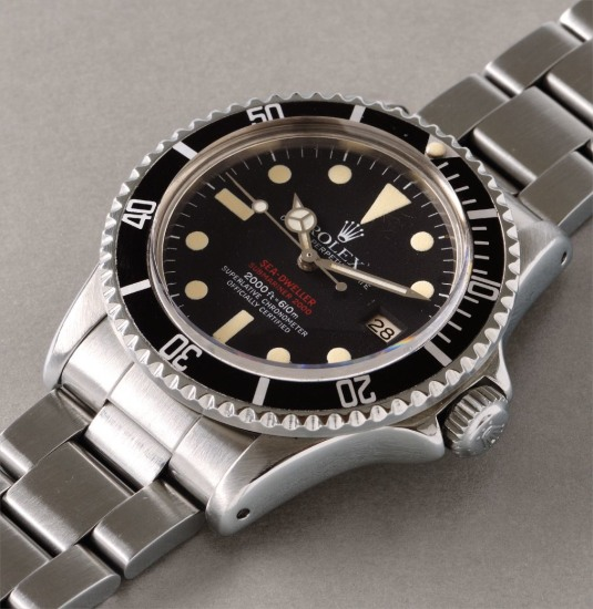A fine and attractive stainless steel diver's wristwatch with date, bracelet, and gas escape valve
