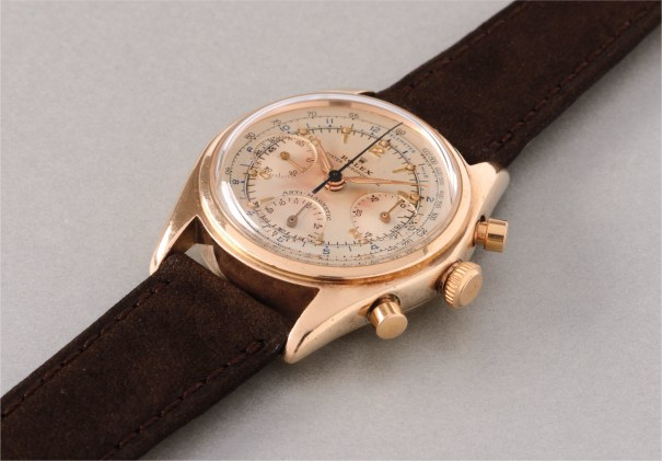 A fine and exceedingly rare gold chronograph wristwatch, with presentation box and service warranty