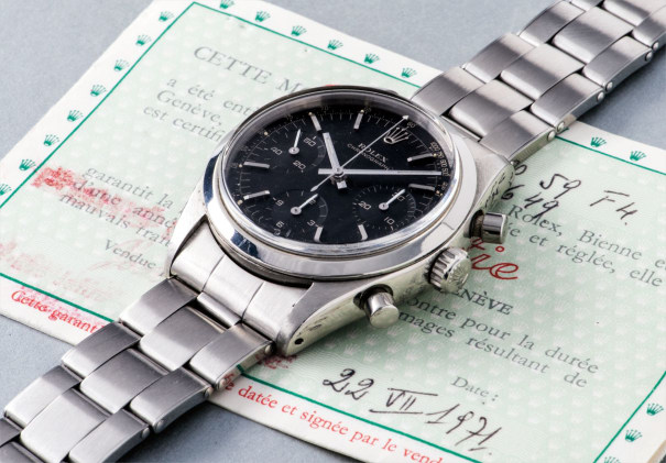 An attractive and very rare stainless steel chronograph wristwatch with black dial, bracelet, accompanied by original certificate
