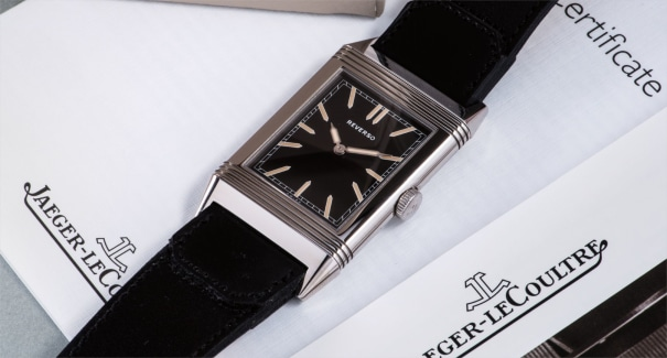 A highly attractive limited edition stainless steel reverso wristwatch with dark brown dial and original handmade cordovan leather strap