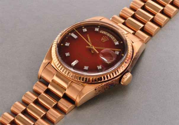 A rare and attractive pink gold and diamond-set calendar wristwatch with bracelet and burnt orange lacquered dégradé dial
