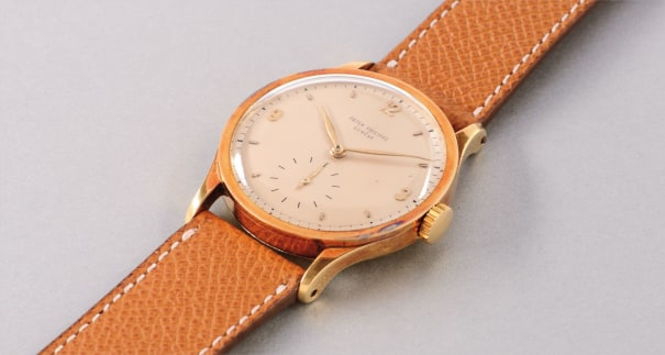 A fine and attractive oversized yellow gold wristwatch with subsidiary seconds