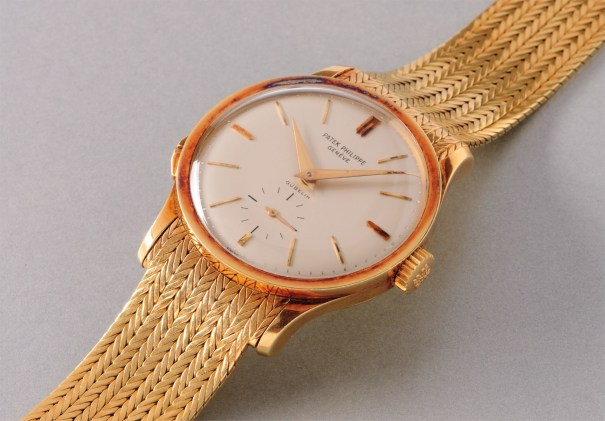 A fine and rare yellow gold wristwatch with separately adjustable hours hand and bracelet, retailed by Gübelin