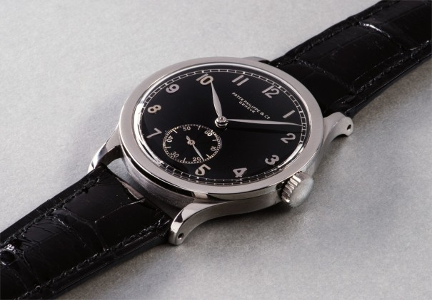 An extremely  rare and highly attractive oversized stainless steel wristwatch with black lacquer telephone dial