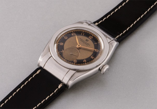 A very rare and most attractive stainless steel wristwatch with two tone dial and hooded lugs