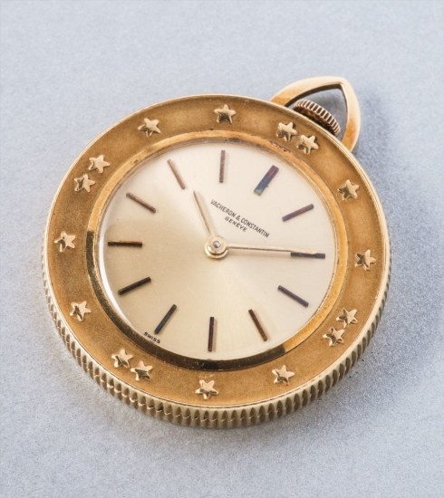 A rare and attractive gold watch with the medallion of the Shah of Iran