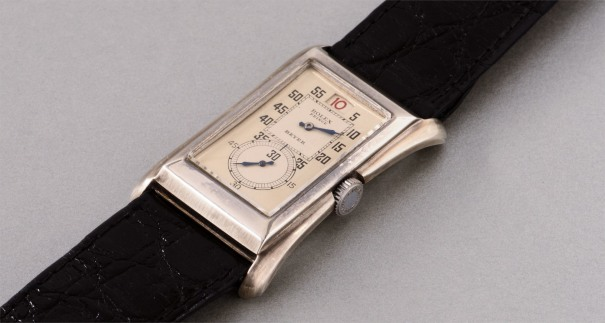 A very well preserved and rare silver rectangular doctor's wristwatch with red jump hour and two-tone silvered dial, retailed by Beyer