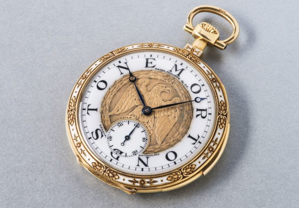 A unique and very attractive yellow gold minute repeating open face pocket watch with enamel and chased work on the bezel and sculpted gold dial depicting an eagle