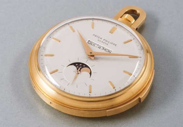 """An extremely rare and fine yellow gold open face minute repeating """"straight line"""" perpetual calendar watch with moon phase"""