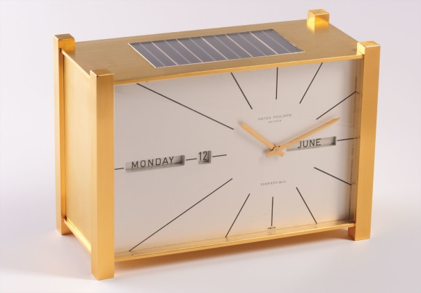 A fine and very rare solar-powered gilt brass table clock with perpetual calendar, retailed by Tiffany & Co.