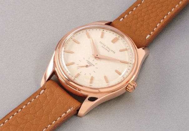 A highly attractive and very rare pink gold wristwatch with enamel dial and bracelet, retailed by Serpico Y Laino