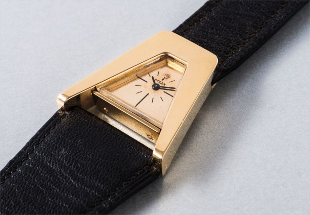 An probably unique and highly unusual asymmetrical yellow gold wristwatch
