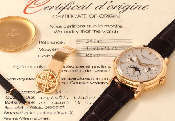 A very rare and attractive yellow gold minute repeating perpetual calendar wristwatch with phases of the moon, retailed by Beyer