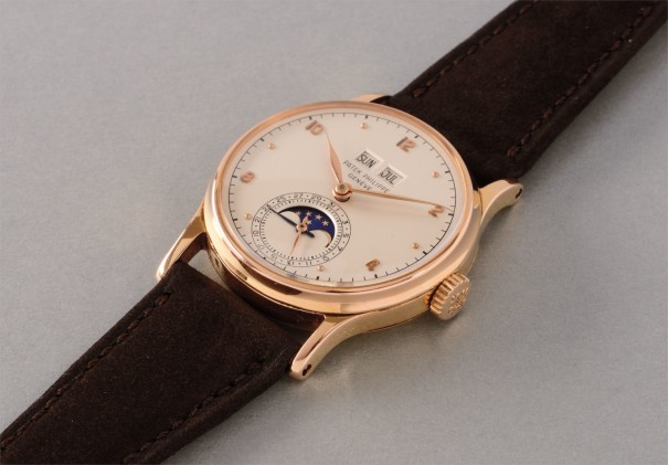 An very attractive and extremely rare pink gold perpetual calendar wristwatch with phases of the moon