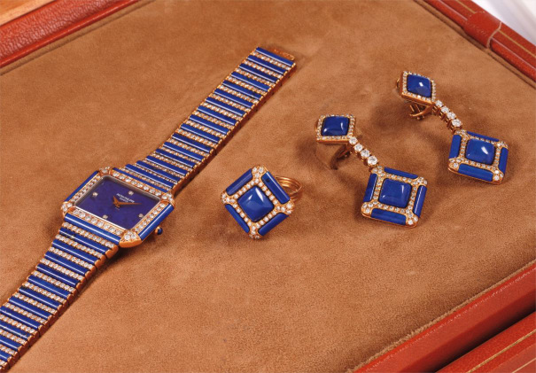 A lady's extremely exclusive yellow gold, lapis lazuli and diamond-set wristwatch with matching ring, earrings and box
